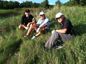 Dave Dahlquist (D2) , Dave Hemminger (D1) and Bob Furstenau take a breather in the midst of getting bashed by one of the incredible Kohler courses. Me? I'm 'D3'.