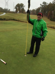 Yours truly trudged in the rain, wind and cold with my friend Alice from Golf for One. We didn't stop very often - only long enough for this shot of me holding the stick on the 5th hole.