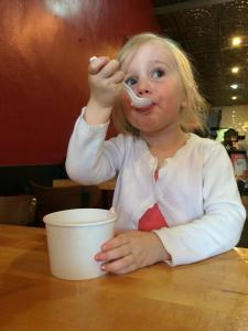 Emma scarfs down some ice cream. She and her Papa will get to know the business end of a spoon and a bowl(s) of ice cream when I visit next month.