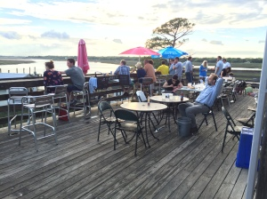 The Bowens Island restaurant is a must-visit deal near Folly Beach. Not high cuisine, but a funky place with good views and great beer. My fishing spot is on the horizon just above the diners.