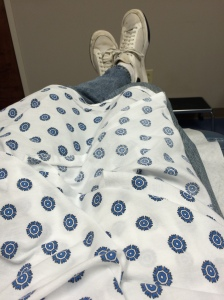 This is what passes for out patient surgery style these days: a butt ugly gown and an old pair of Rod Laver shoes.